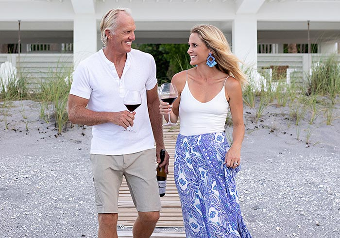 Image of Greg Norman and Greg Norman, Jr. in a beach buggy