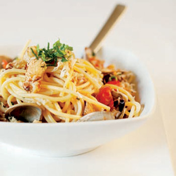 Image of Spaghetti with Fresh Crab, Clams, Mint and Spicy Cherry Tomatoes